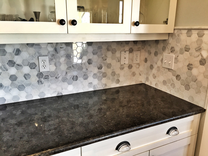 black and white backsplash with marble counter
