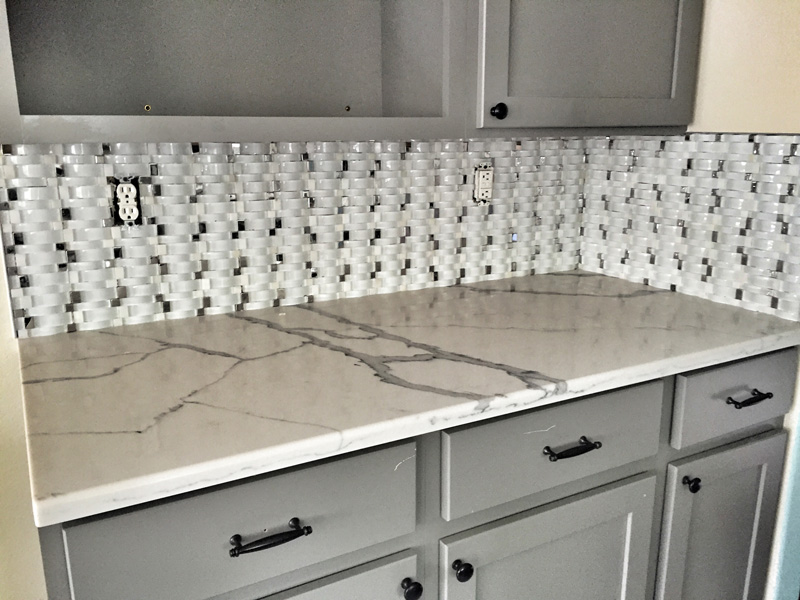 marble-couter-with-tile-backsplash