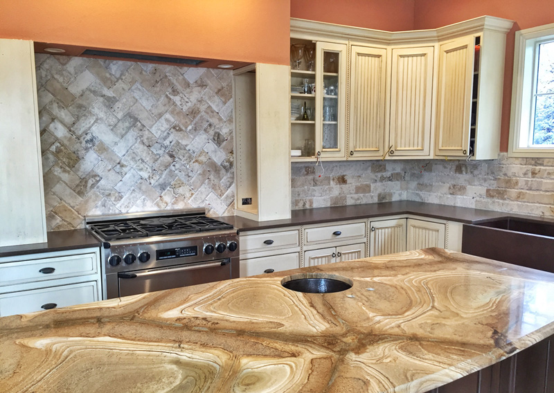 marble countertop and tile backsplash
