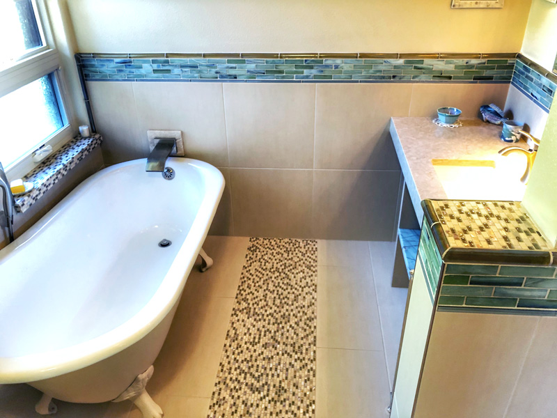 tub-with-custom-tile-floor-and-trim
